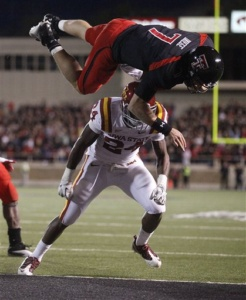 Texas Tech's Seth Doege (7) dives for a touchdown over Iowa State's Durrell Givens (24) during an NCAA college football game, in Lubbock, Texas, Saturday, Oct. 29, 2011. (AP Photo/Lubbock Avalanche-Journal, Stephen Spillman)